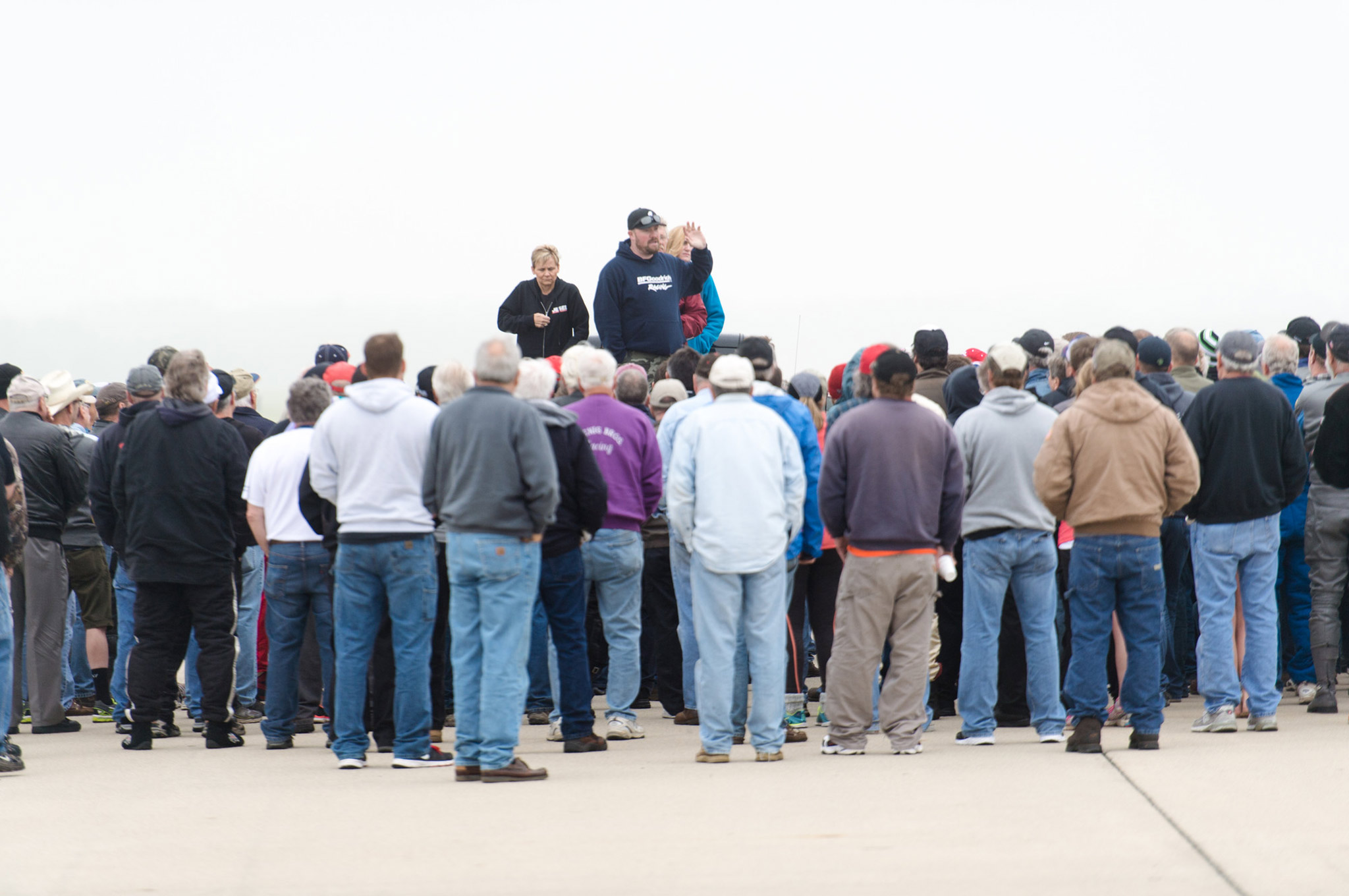 Tonya Turk and Brian Lohnes take turns addressing the crowd on safety, race procedures, and other ECTA announcements at the driver meeting prior to the race.