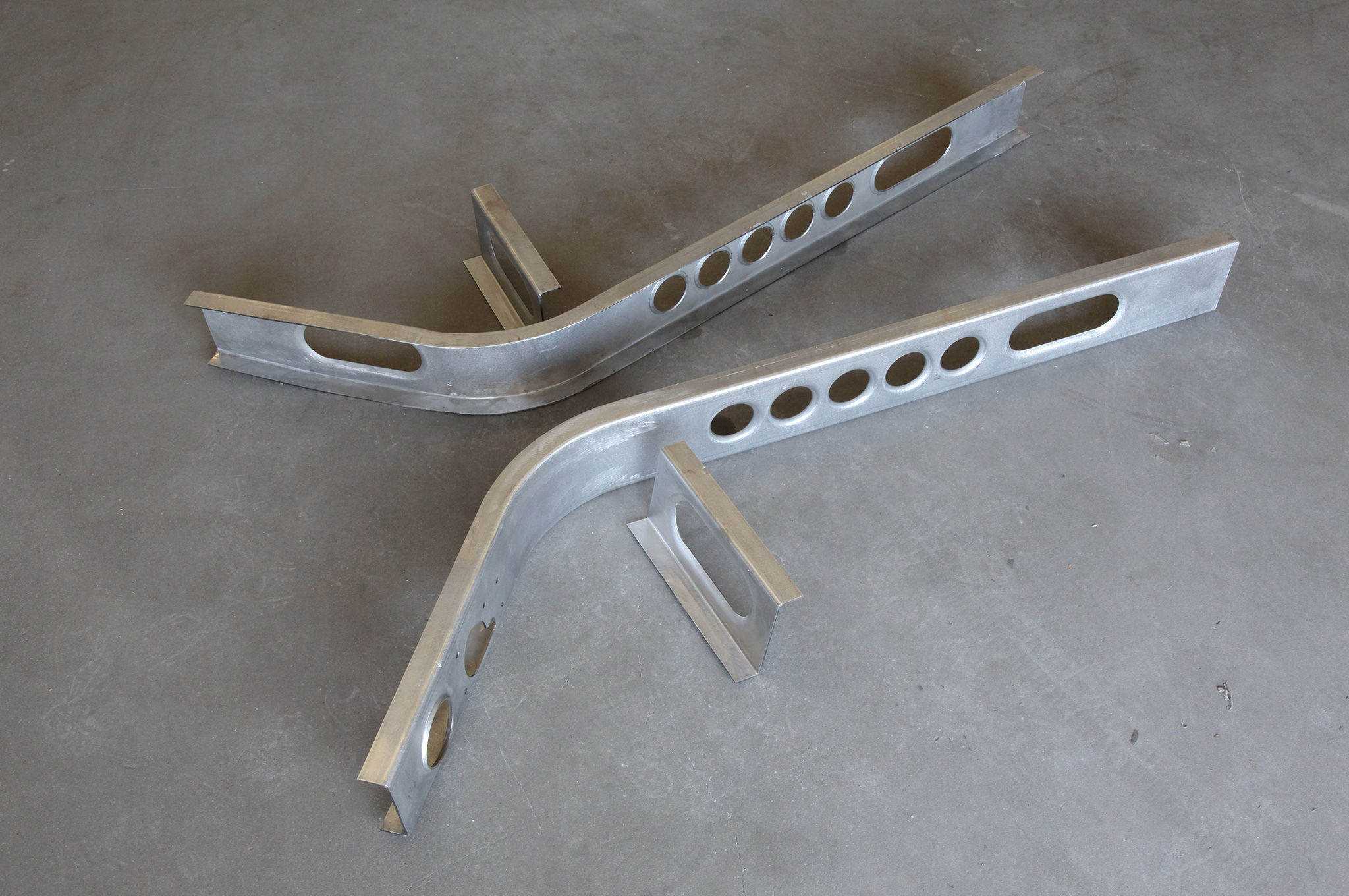 The X-member parts from Ionia also include some side bracing, with holes added so you can run exhaust tubing through them.