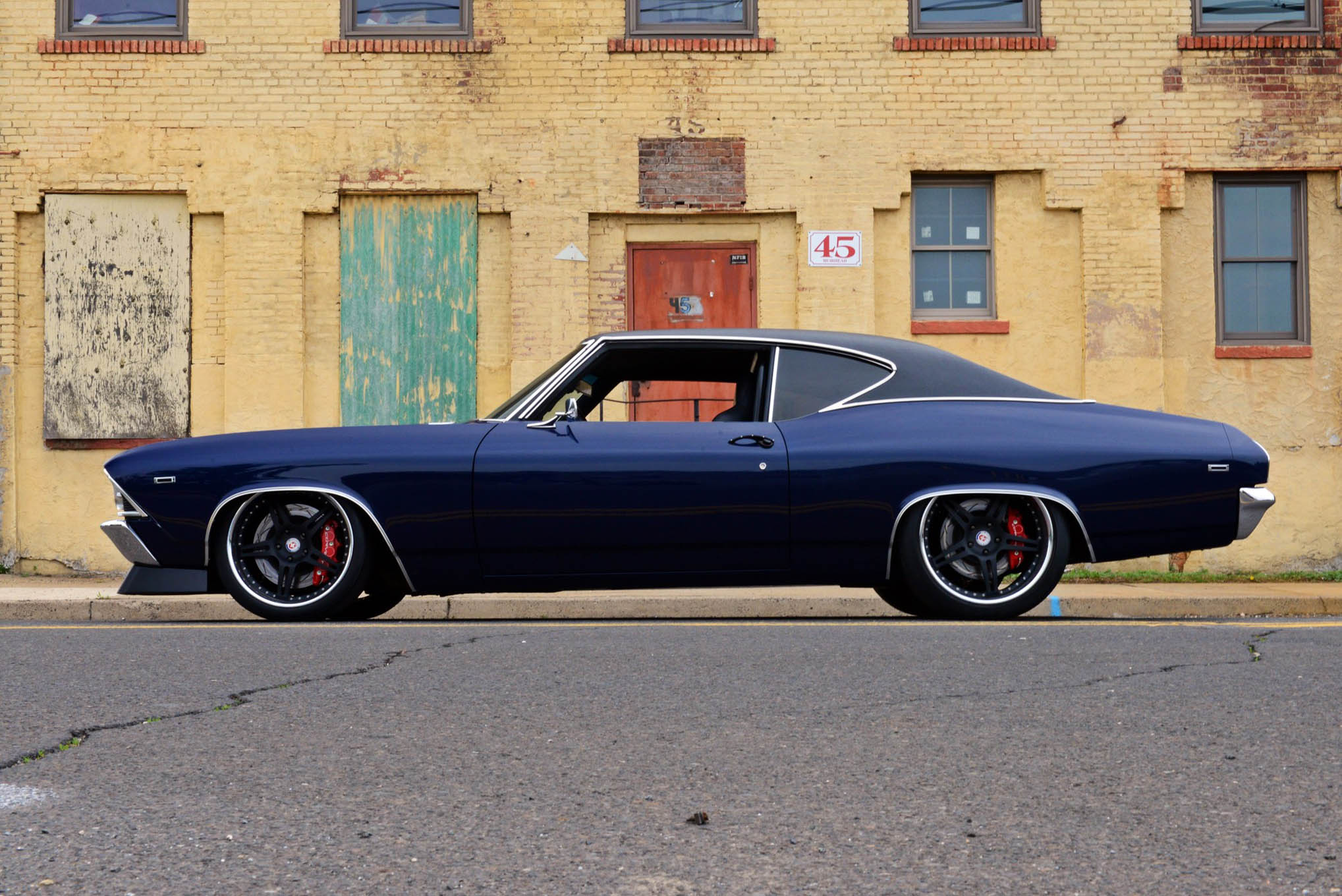 Nick's 1969 Chevelle was designed to sit 4-6 inches from ground to top of the roof, and the rockers sit just 4.75 inches from the ground up front and 5.75 inches near the rear wheel well. Nick rides with a C6 corvette suspension up front, and a custom four-link suspension in the rear. In the trunk you'll find a custom cantilevered rocker rear suspension designed and built by the owner. Double adjustable coilovers with Ride Tech springs and splined sway bars up front and out back round out the suspension mods.