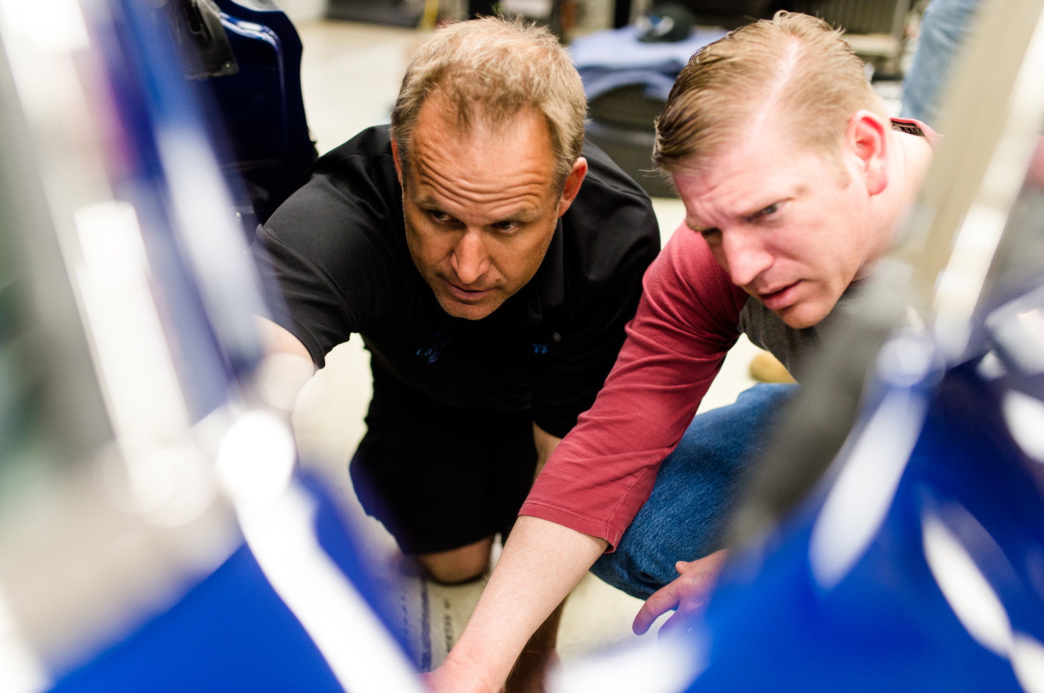 Troy, left, explains to David some of the new modifications made to the car. Here they're taking a look at the loop on the throttle pedal that allows the driver's foot to pull the throttle back up in case it gets stuck.