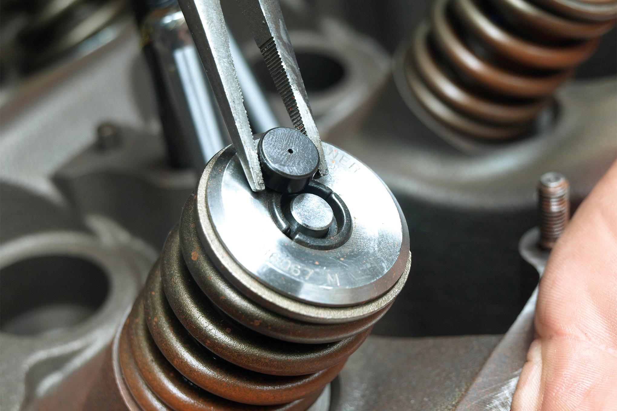 """Tom Hoover, Willem Weertman, and the rest of the 426 Hemi's """"fathers"""" trimmed valve mass by using 5/16 stems. Though rugged, lash caps are a smart addition to prevent tip wear with stiff roller-spec springs. Donnie replaced the M.P. moly retainers with titanium units from Comp."""