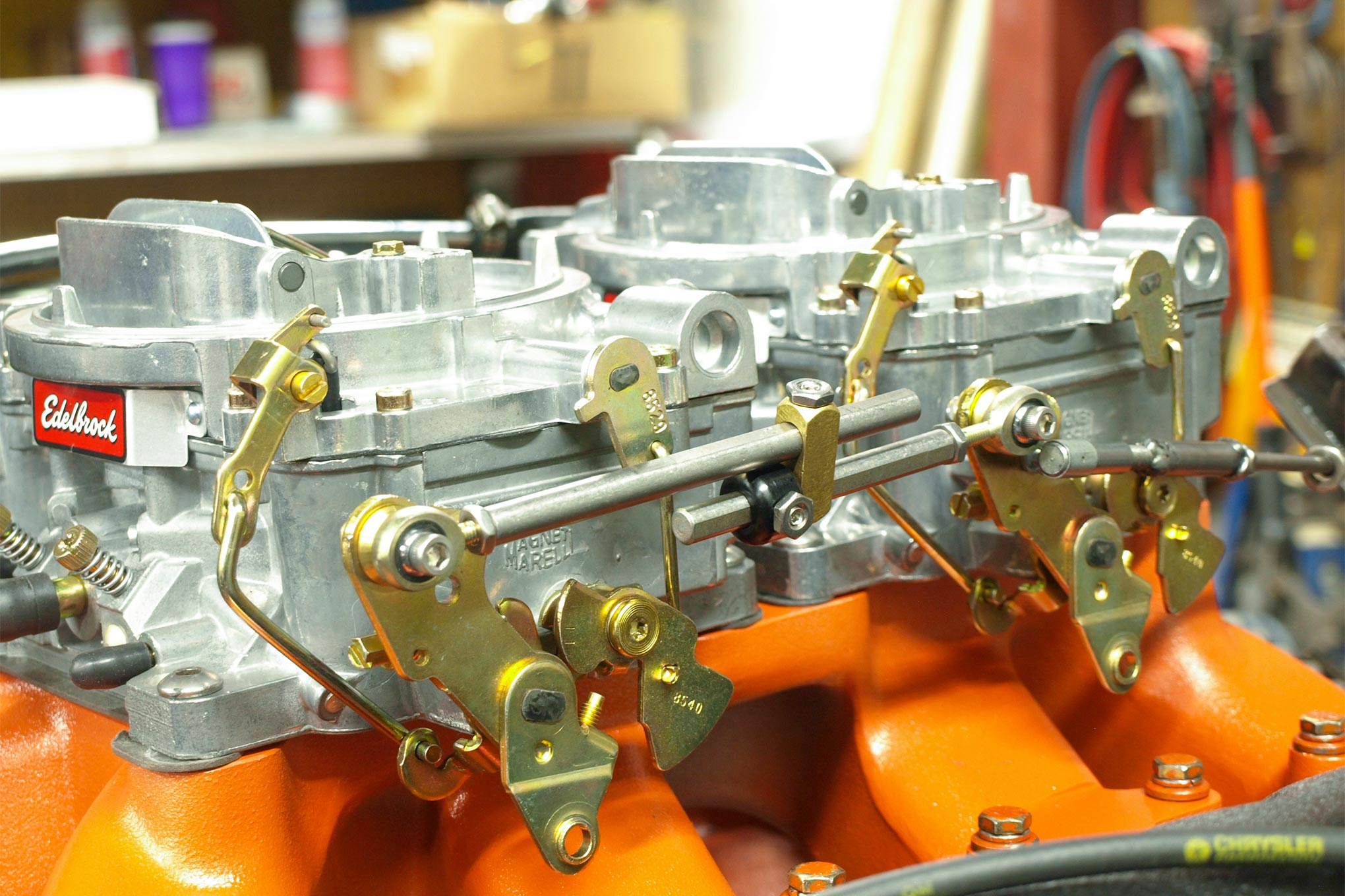 And for the grand finale, and to answer those who insist Hemis must have dual-quads to fill the void between those massive rocker covers, the Edelbrock Air Gap 5210 with twin Edebrock Performer 1406 carbs replaced the M1 and Holley. Horsepower jumped to 594.5 at 6,200 rpm with 542.4 lb-ft at 5,200 rpm. R.A.D. was amazed by how the dual Performers delivered nearly ideal fuel/air ratios right from the box. No jetting or metering changes were made.