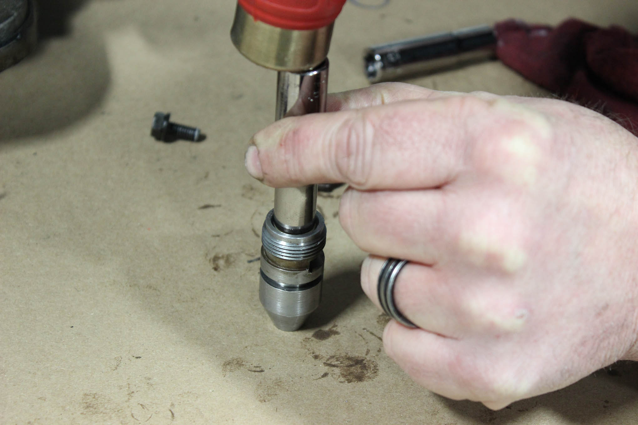 A new lip seal is driven in with a hammer and socket of the right diameter.