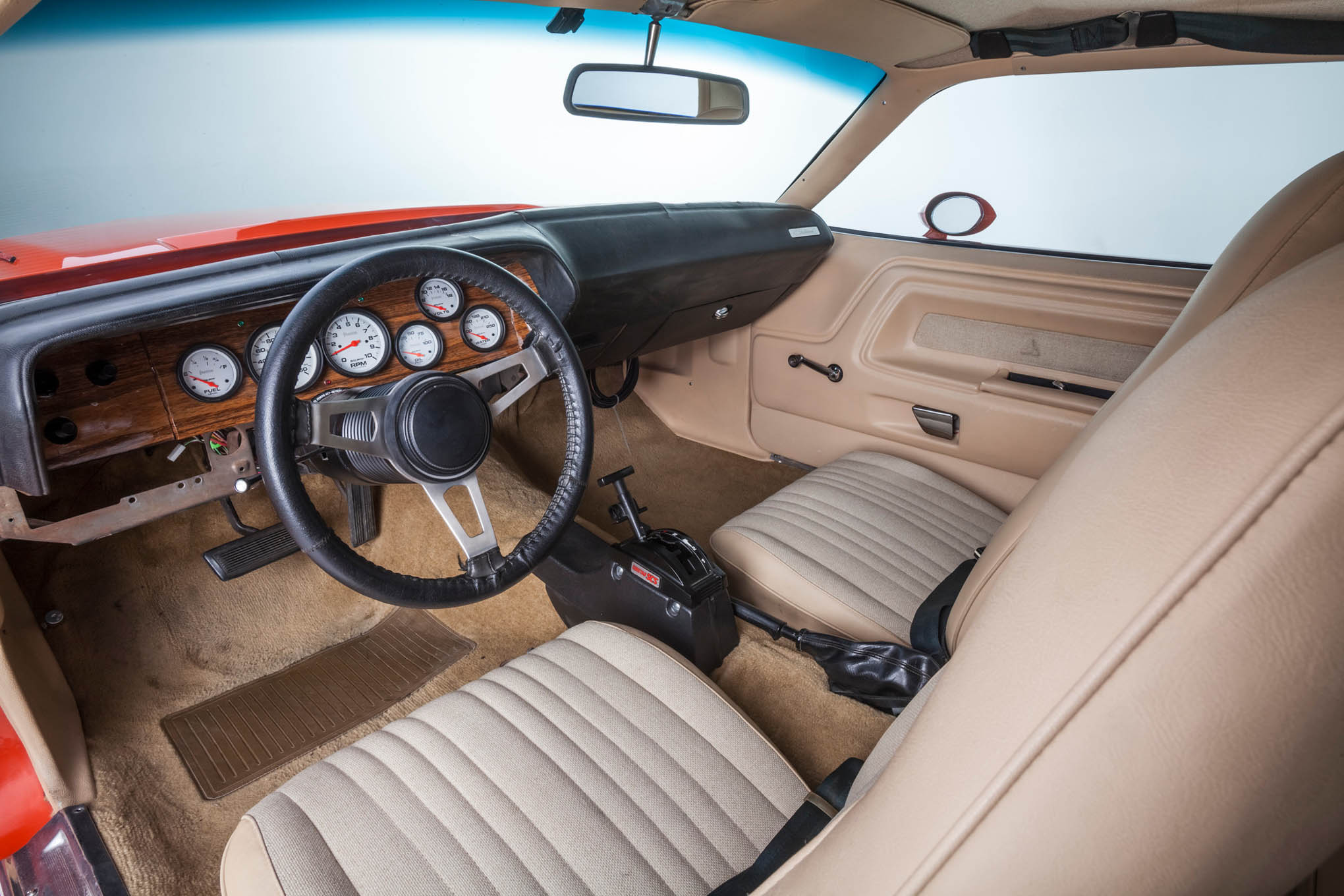 In a nod to the car's predominant use as a street vehicle, Guisto retained most of the original factory interior, including the buckets seats and belts. Auto Meter gauges, a Cheetah Turbo Action shifter, and a fire extinguisher are the exception.