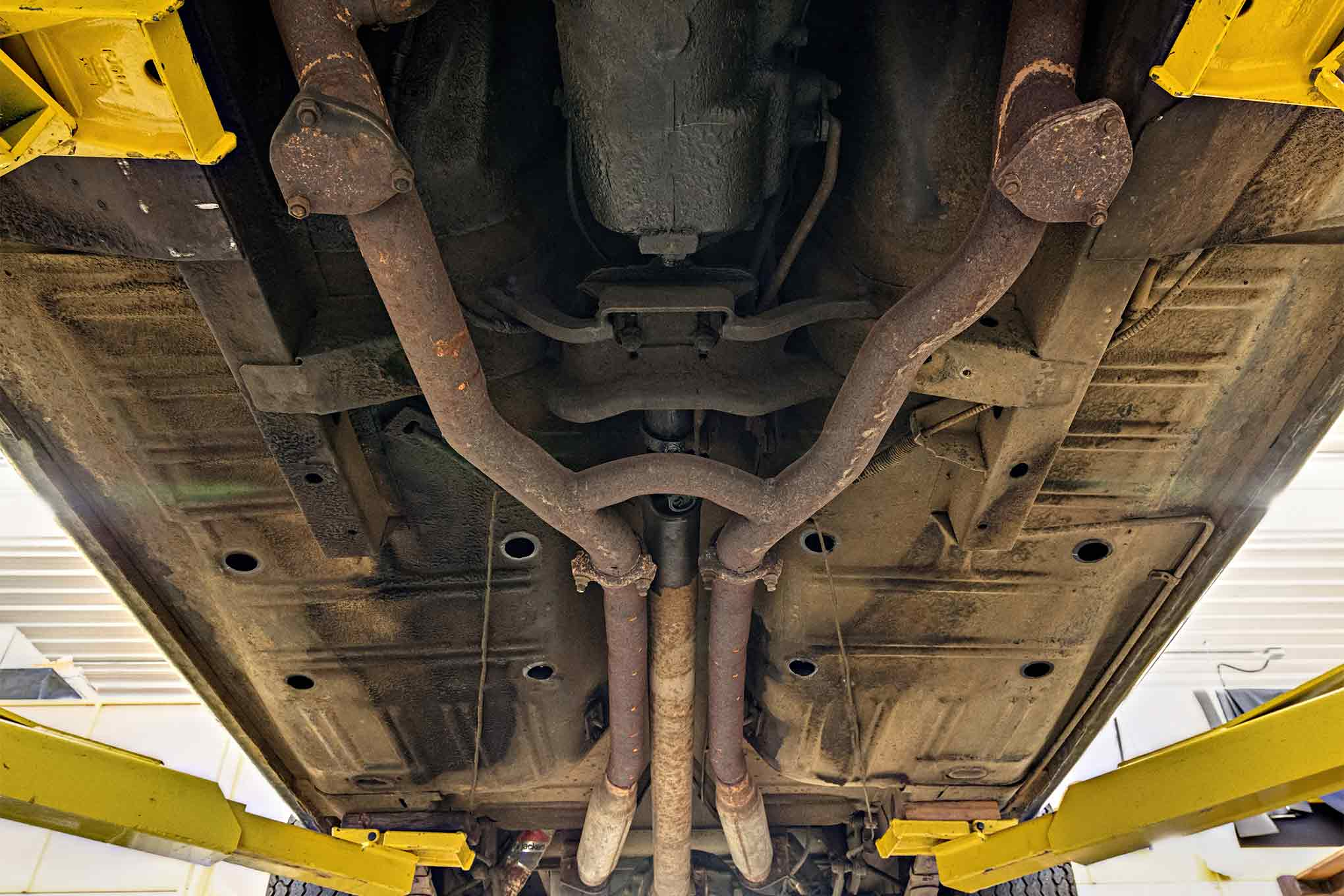 These exhaust dumps are obviously not original, but also would be unlikely on a street-only car. Still, it seems odd to add these with the stock iron manifolds in place. The exhaust is all-original; no headers have ever been installed.
