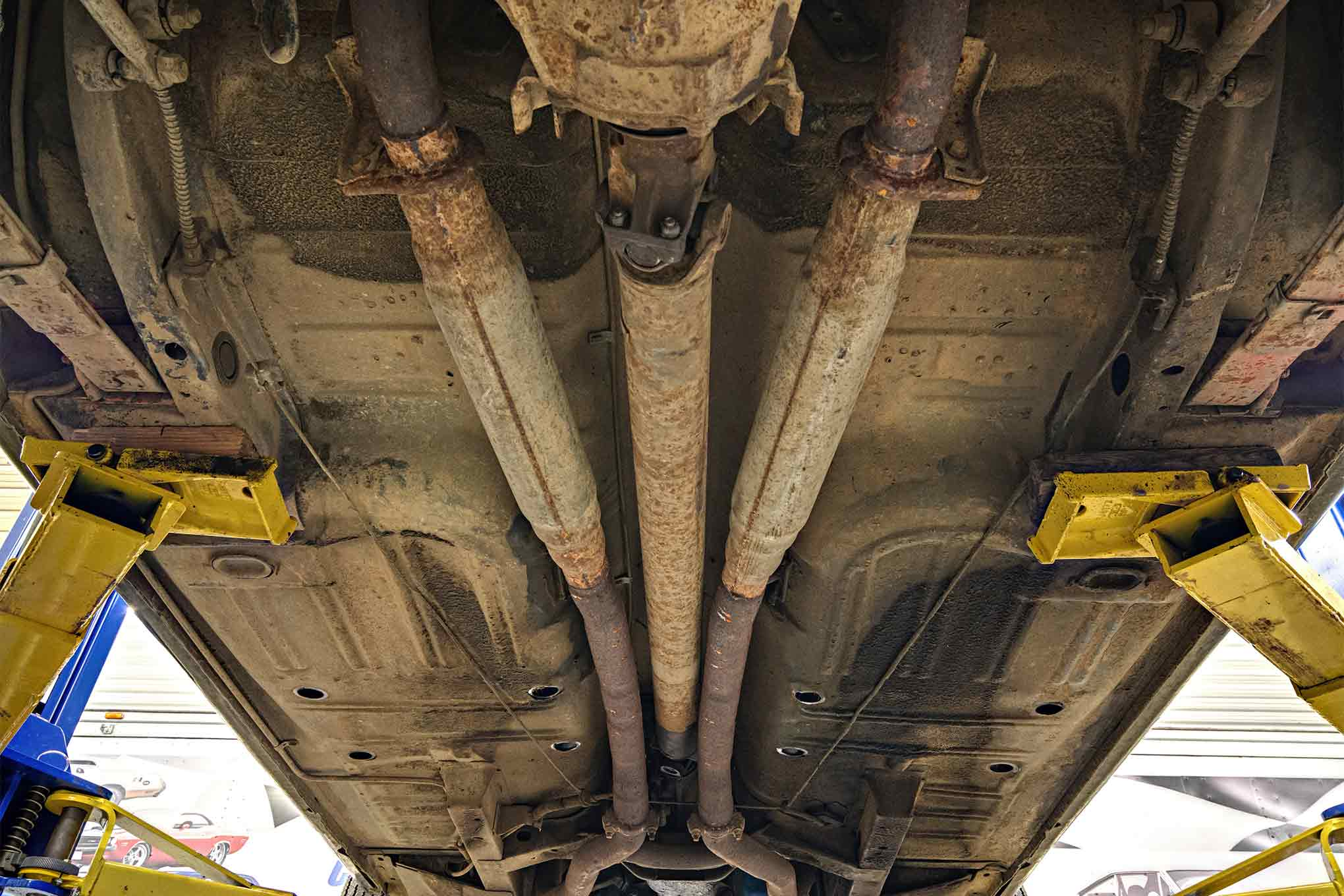 You would not expect to find the factory pipes on a car this old, but those are the original resonators. Note how clean the bottom of this car is. This is as it arrived at MCR before any cleaning at all.