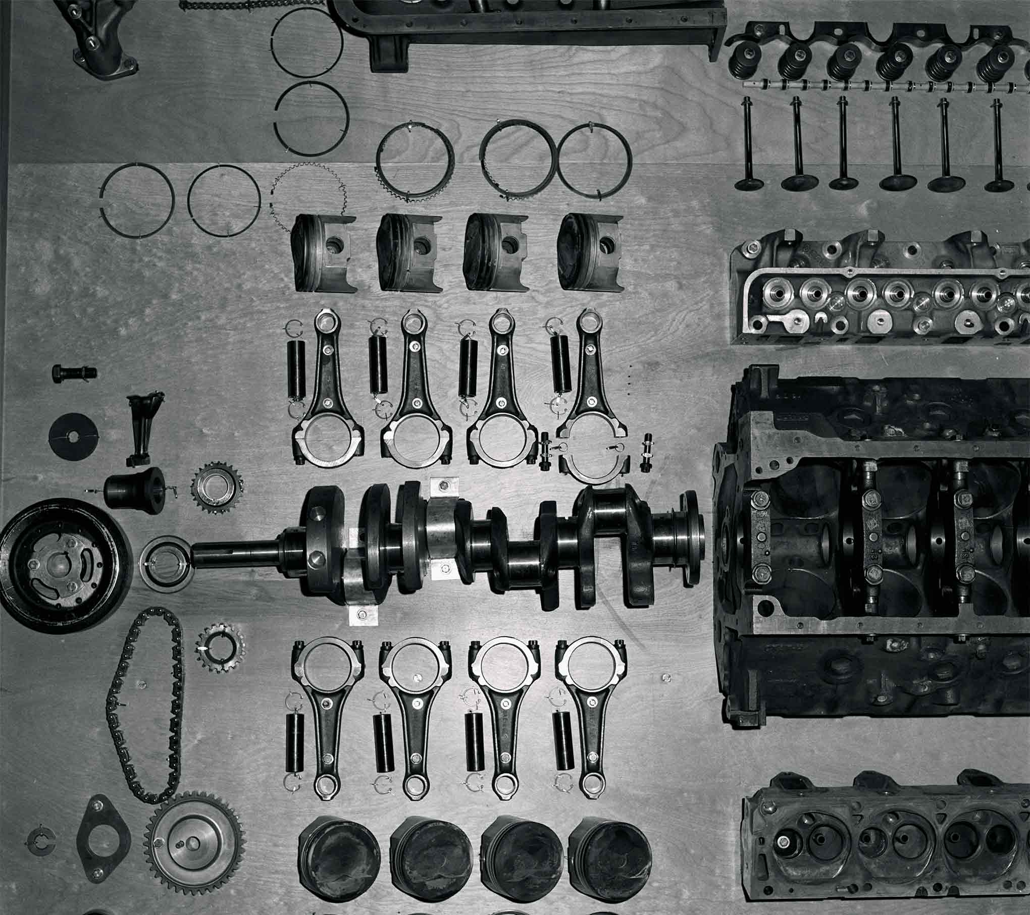 "Every part of the engine was exposed in this exploded display. The chain and sprockets to the left attach to the crank and spins two scavenge pumps for the dry-sump system. ""Le Mans"" forged-steel connecting rods featured stronger large end and 7/16-inch cap screws. The ""Le Mans"" C5AZ-6303-C forged crankshaft accepts standard main bearing shells of production 427 engines. The rocker arms are a ball-stud design as opposed to a presumed roller rocker."
