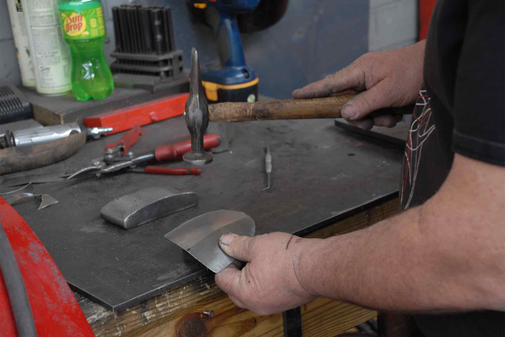Even after using the planishing hammer to form the curves the edges will require a bit of gentle hammer and dolly work.