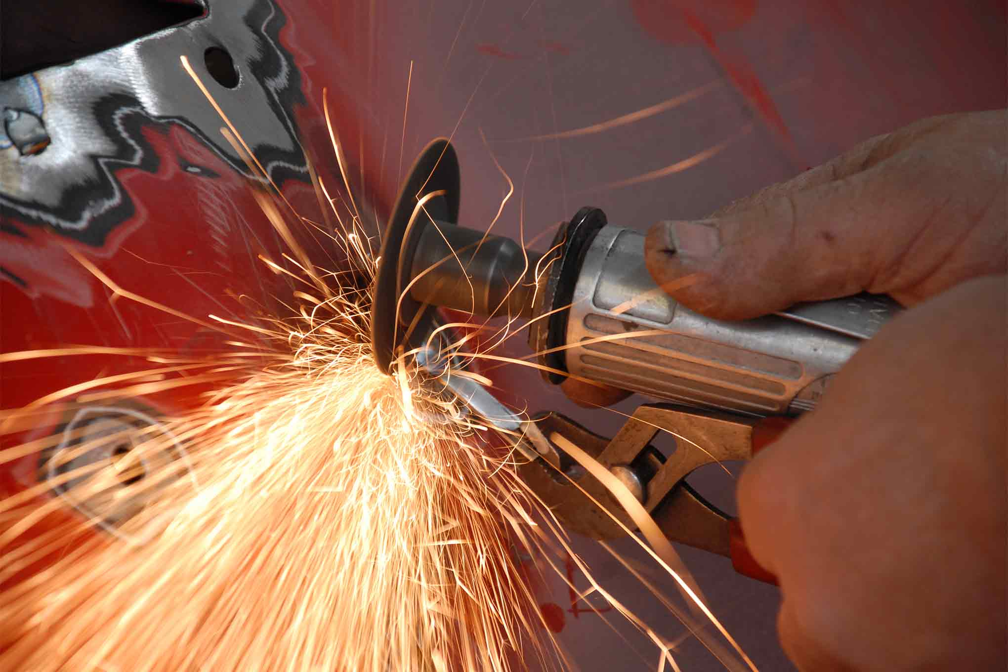 """After the tack weld he simply cuts off the """"handle"""" and has a nice small plug for the hole. No clamping was required."""