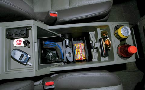 Center console is reconfigurable. Smart touches include a rubber mat to keep small objects from rattling.