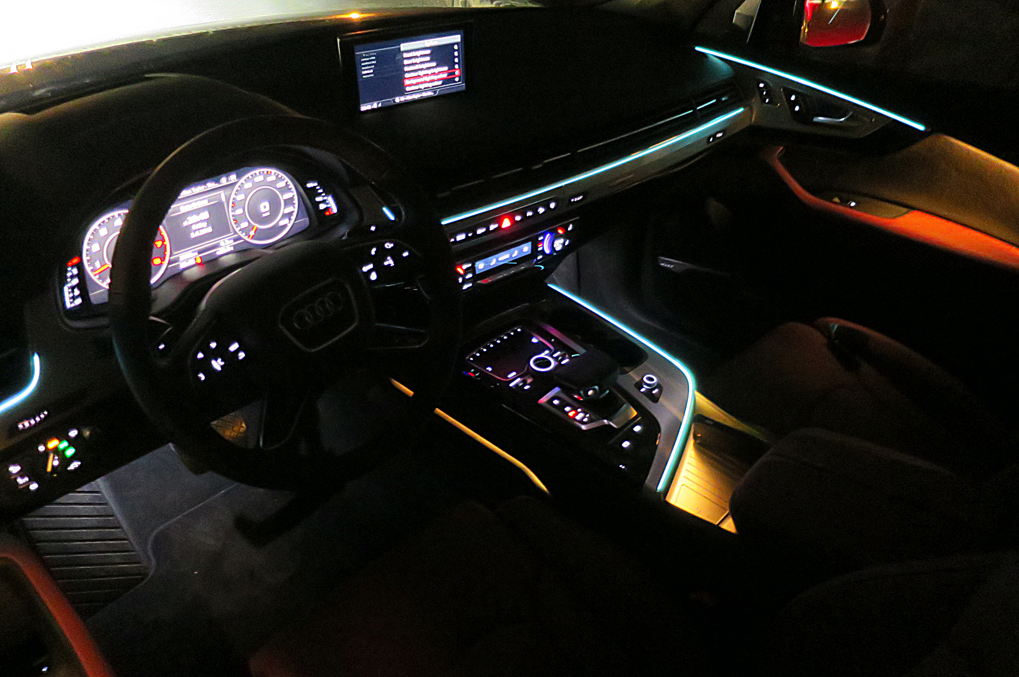 Crisp lines of ambient lighting accent the cockpit, and the color of these lines and of the gentle flood lighting can be set independently. (I've selected a Christmassy light green for the lines and red for the floods.)