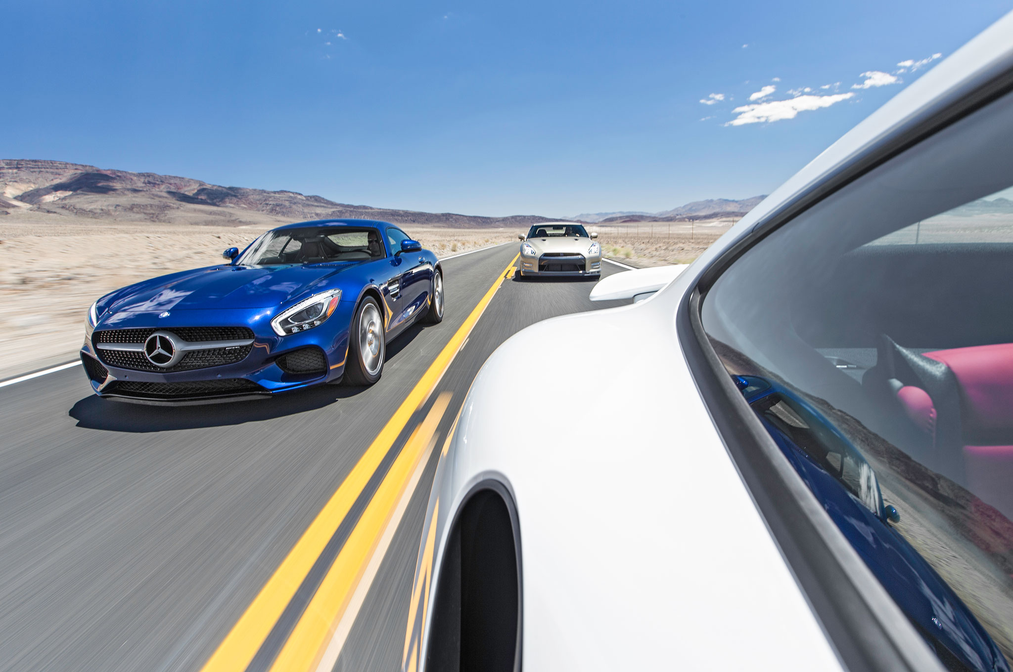 Happiness is a long, straight road where you can stretch a 500-plus horsepower car's legs, followed by a nice twisty one where you can whip it through the corners.