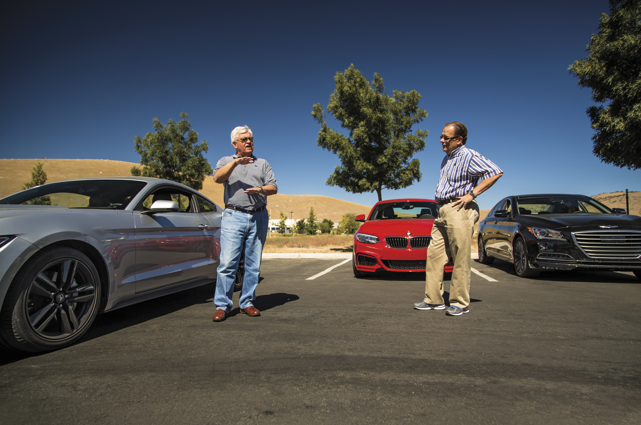 Grain and gloss, hem flanges and crashboxes—Tom (left, at 2015 Car of the Year testing) and Chris don't just know the jargon. They invented it.