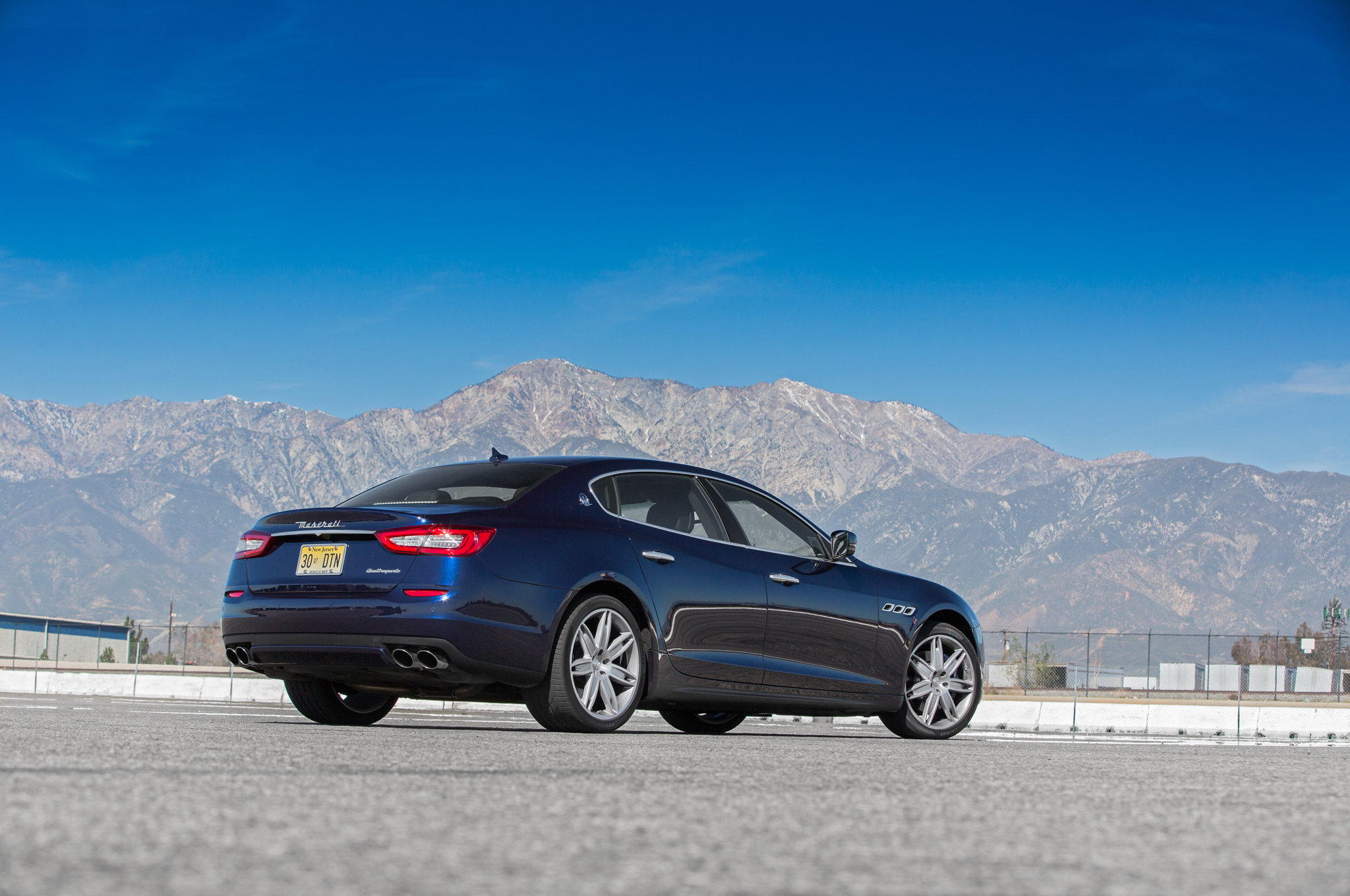 The Quattroporte's power-operated trunk features a helpful lock-and-close button, and we're also fans of the rear seat's USB charger.