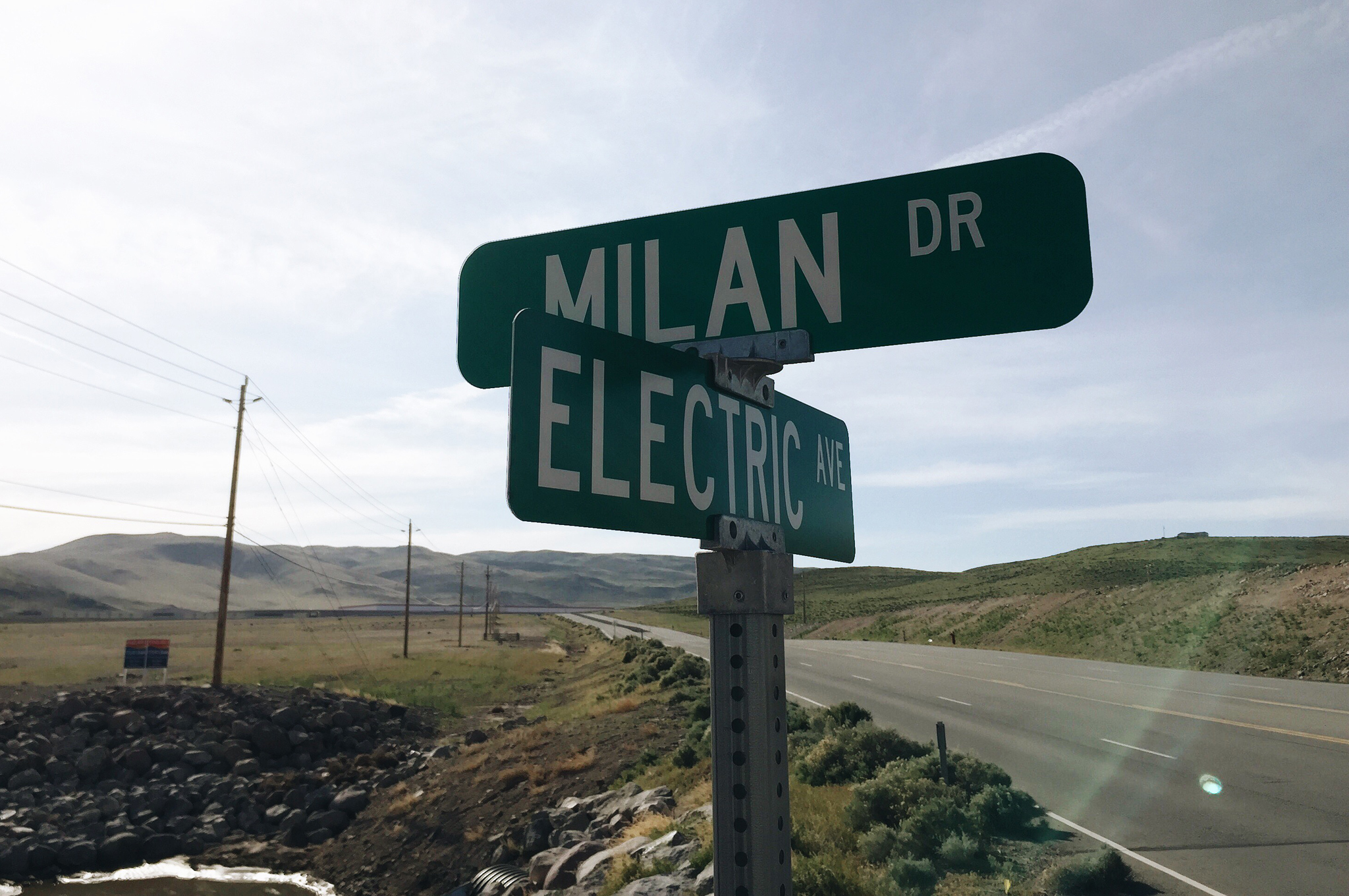 Under this Electric Avenue sign, in the distance, is the Tesla Gigafactory