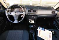 TOYOTA: The new-for-'01 S model adds a distinctly sporty flavor to the Corolla. We have mixed reviews on the red-on-black gauges, but everyone likes the red stitching and