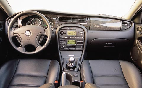 2002 jaguar x type one year test review update motor trend for Jaguar x type interior parts