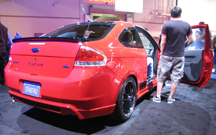<strong>Ford Focus by 3D Carbon</strong>Inspired by a love for all things European, 3D Carbon outfits the 2008 Focus four-door sedan with its Euro Series body kit. The six-piece includes front air dam, side skirts, rear lower skirt, rear deck lid spoiler and upper roof spoiler. A Webasto 900 Series twin-venting sunroof helps open up the interior. The sharp little sedan's wheel wells are filled with 19-inch, forged aluminum NC wheels wearing Pirelli rubber. The interior is decked out in two-tone Baracuda leather by Katzkin with sound supplied by Blaupunkt.