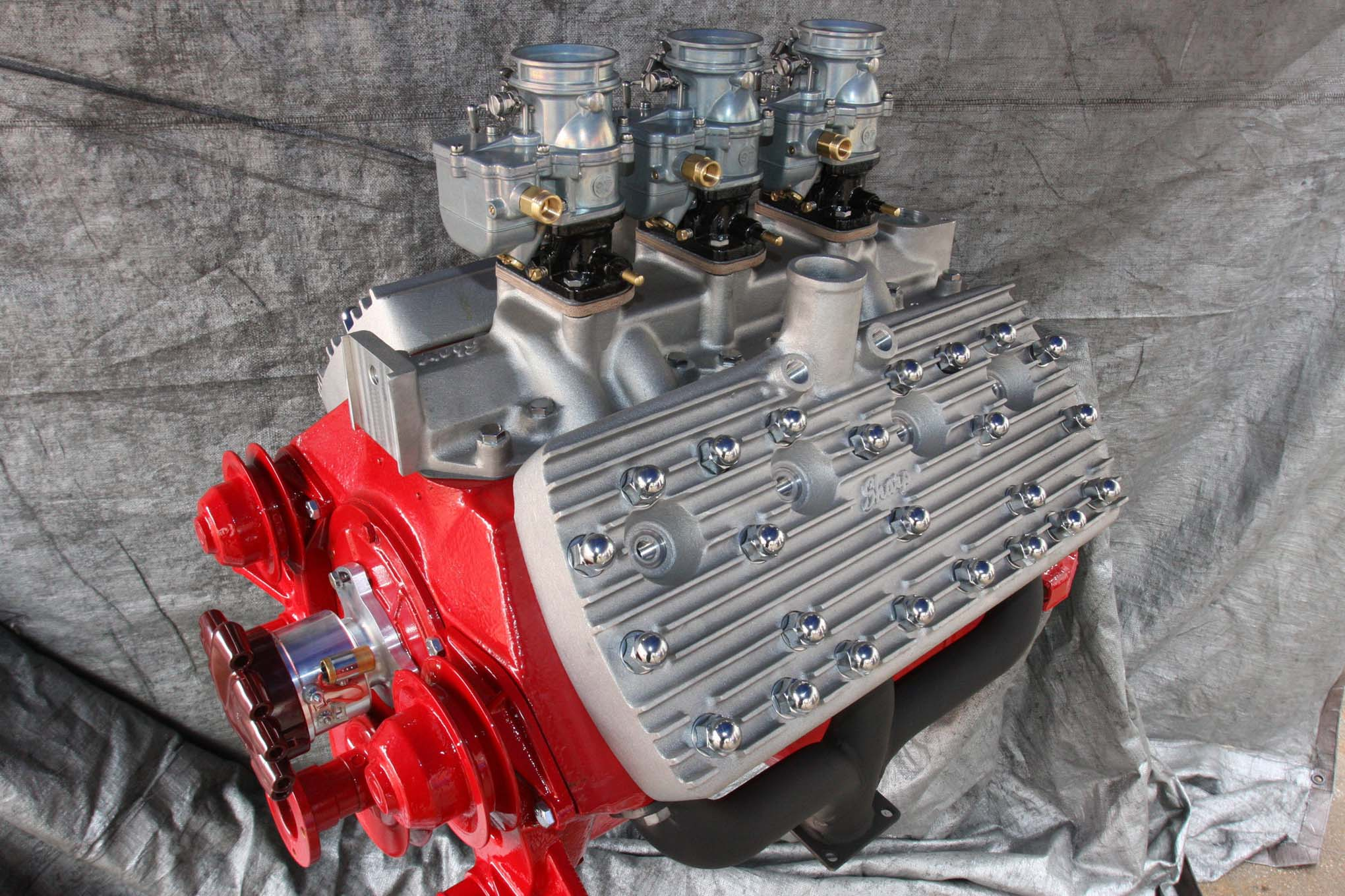 The classic 24 stud 59a ford flathead with a trio of stromberg 97s and aluminum