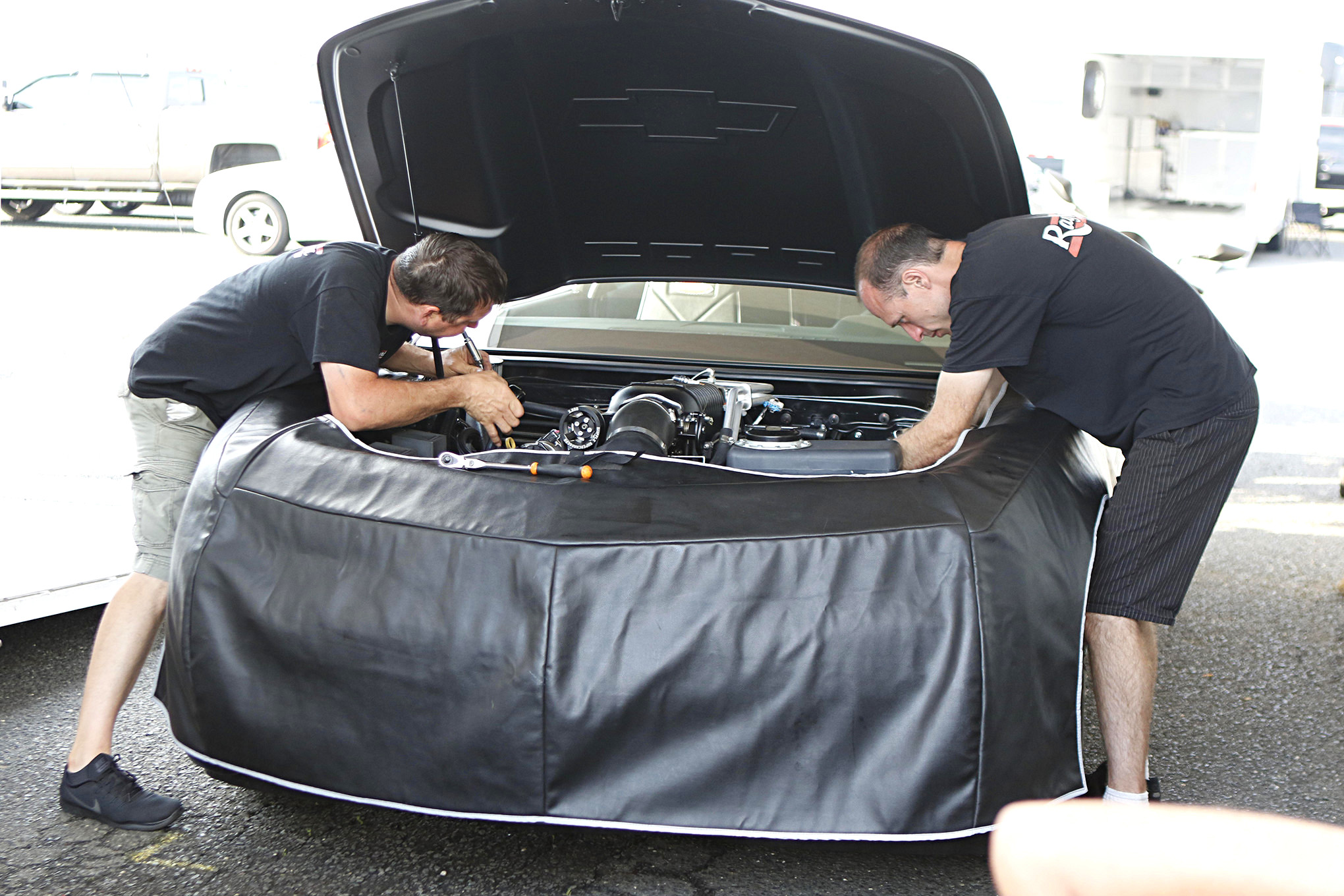 Barton and friend Todd Hoven put the final touches on Gary Wolkwitz's 2015 COPO Camaro prior to the final.