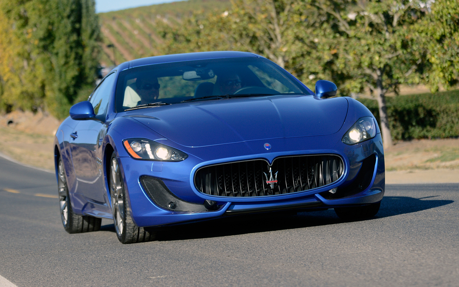 https://enthusiastnetwork.s3.amazonaws.com/uploads/sites/5/2012/11/2013-Maserati-Granturismo-Sport-front-end-in-motion.jpg?impolicy=entryimage