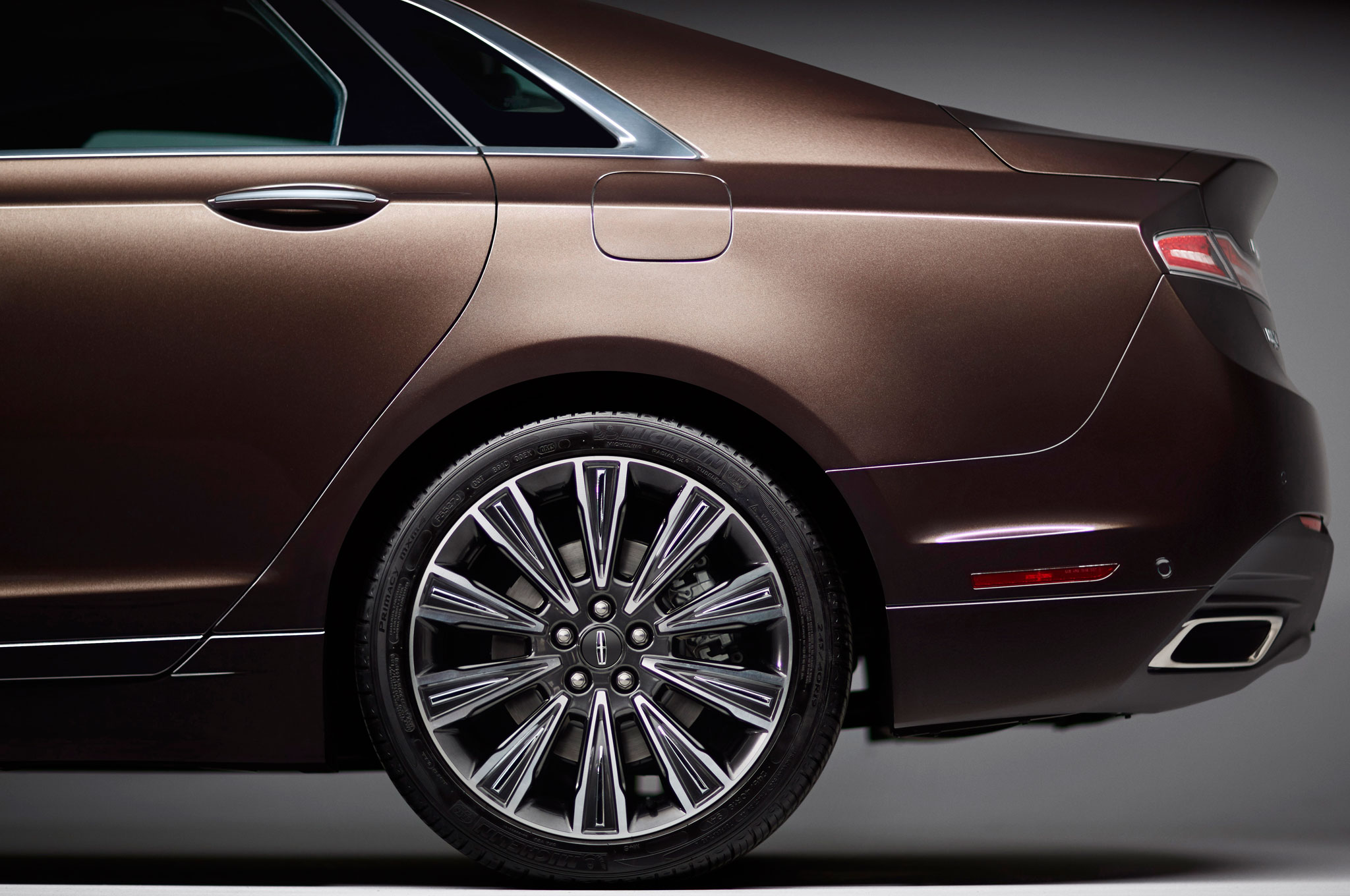 https://enthusiastnetwork.s3.amazonaws.com/uploads/sites/5/2013/08/Lincoln-MKZ-Black-Label-Indulgence-rear-side-and-wheel.jpg?impolicy=entryimage