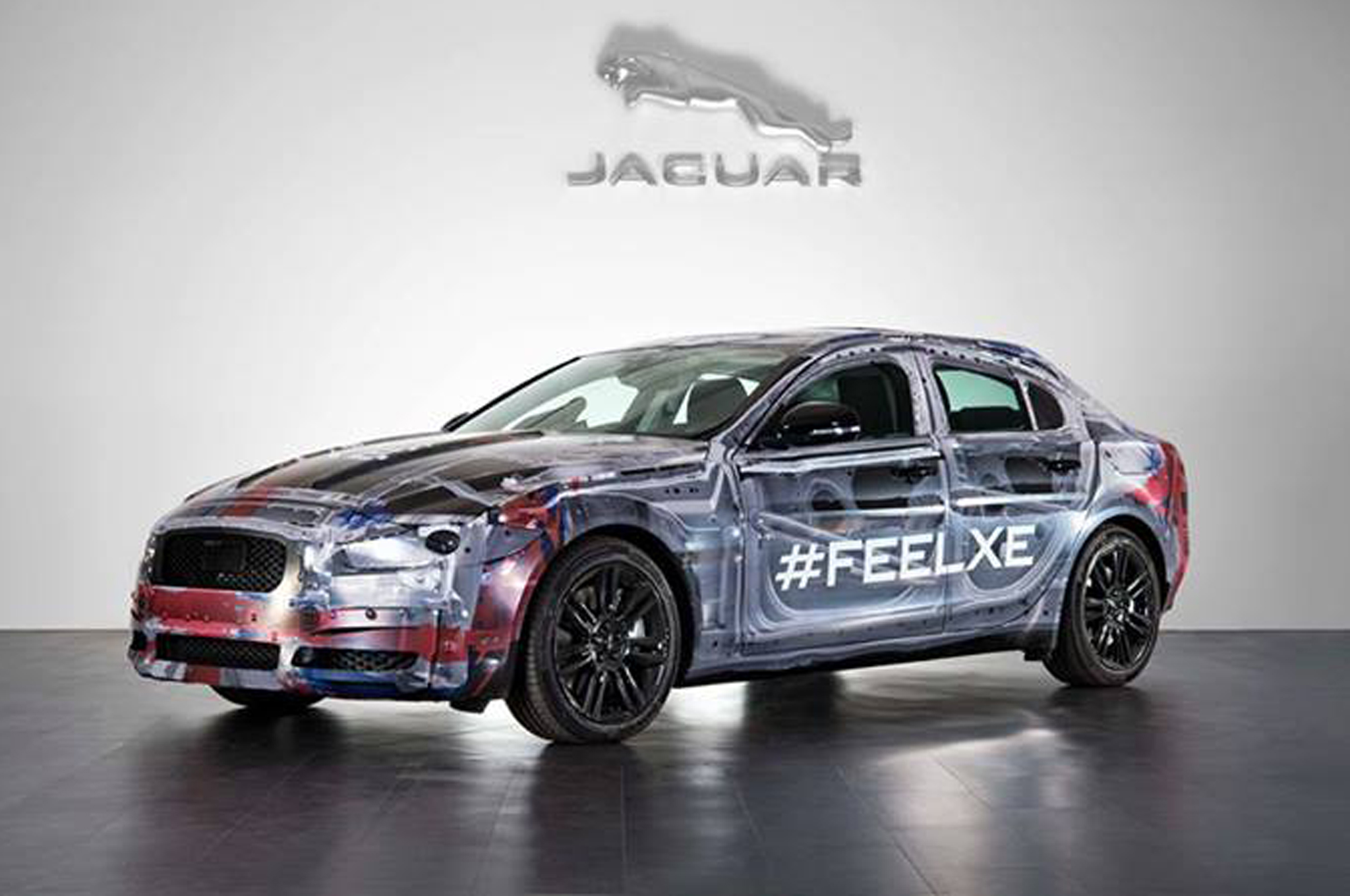 Surprise! Jaguar Offers Closer Look at Camouflaged XE on Facebook