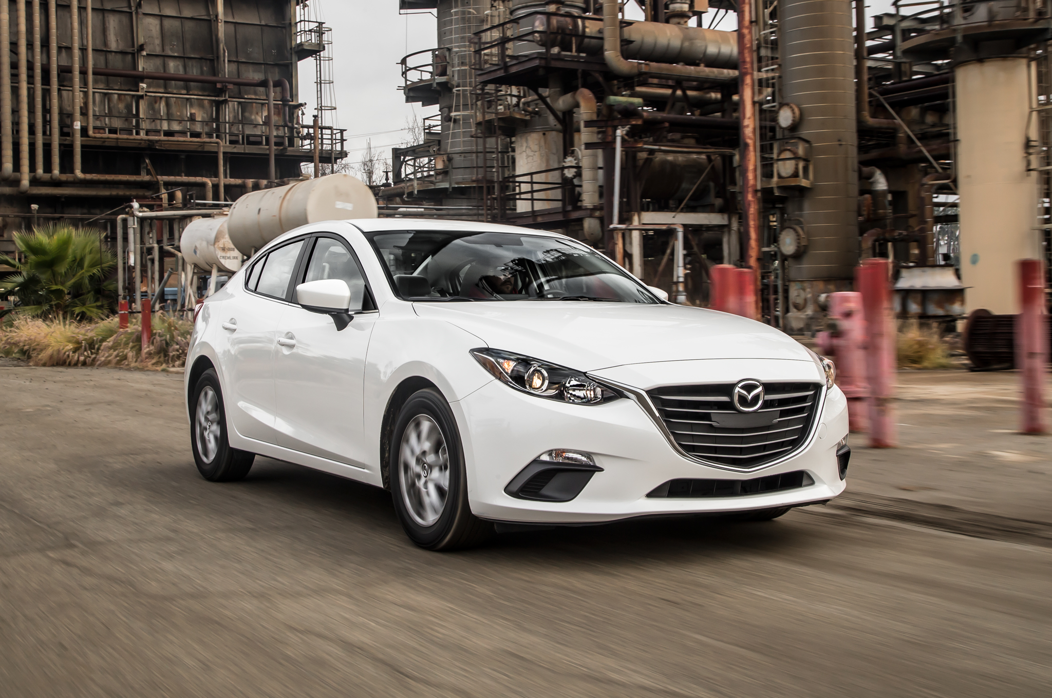 https://enthusiastnetwork.s3.amazonaws.com/uploads/sites/5/2014/08/2014-Mazda3-i-Touring-front-three-quarters-in-motion.jpg?impolicy=entryimage